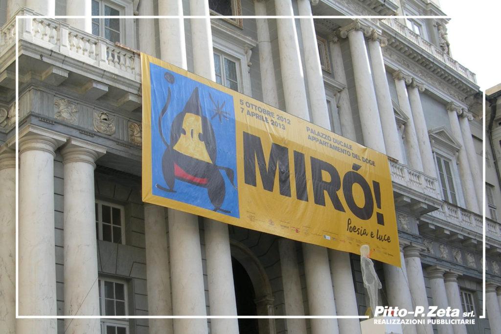 Allestimento esterno mostra Mirò, Palazzo Ducale, Genova. Stampa e montaggio stendardo.
